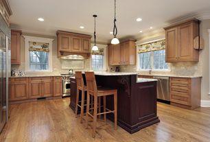 Traditional Kitchen with Simple granite counters, Hardwood floors, Pendant light, Breakfast bar, Custom hood, Raised panel