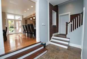 Traditional Staircase with Built-in bookshelf, six panel door, curved staircase, Hardwood floors, Standard height