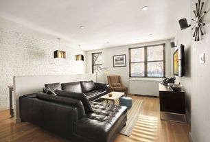 Contemporary Living Room with Wall sconce, Built-in bookshelf, double-hung window, Standard height, interior brick