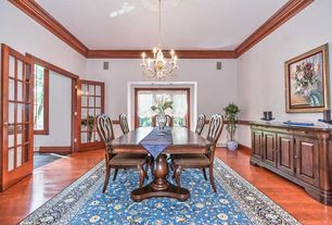 Craftsman Dining Room with Crown molding, Chair rail, Standard height, French doors, Chandelier, Hardwood floors