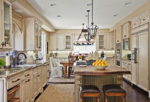 Country Kitchen with Flat panel cabinets, Standard height, Framed Partial Panel, Breakfast bar, Chandelier, can lights