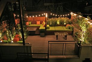 Contemporary Deck with Exterior accent lighting, Rooftop deck, Fence, Raised beds, Fire pit, Gate, Built-in outdoor bed
