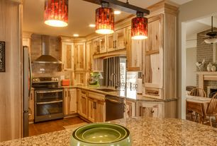 Rustic Kitchen with Flat panel cabinets, dishwasher, full backsplash, Multiple Refrigerators, gas range, Limestone Tile