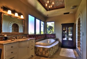 Mediterranean Master Bathroom with mexican tile backsplash, Simple granite counters, European Cabinets, Undermount sink