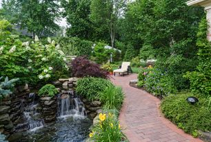 Traditional Landscape/Yard with exterior stone floors, Pathway, Pond