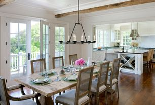 "Cottage Dining Room with French doors, Restoration Hardware Cabot Round Chandelier 36"", Beadboard, Crown molding, Chandelier"