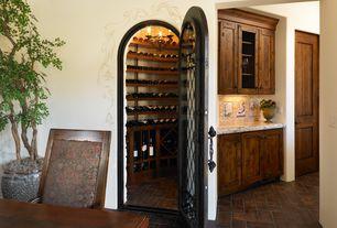 Mediterranean Wine Cellar with Herringbone brick floor, VintageView 9-Bottle Wall Mounted Presentation Wine Rack, Chandelier