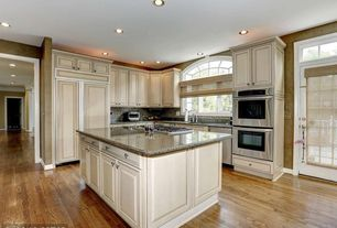 Traditional Kitchen with Standard height, full backsplash, can lights, double wall oven, Kitchen island, Undermount sink
