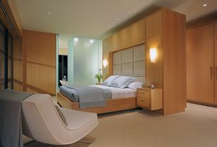 Contemporary Master Bedroom with Carpet, High ceiling, Wall sconce, Built-in bookshelf, Stella lounge chair by blu dot