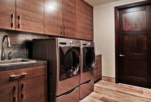 Contemporary Laundry Room with Hardwood floors, Drop-in sink, laundry sink, specialty door, Paint 1, Built-in bookshelf
