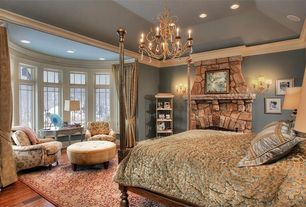 Traditional Master Bedroom with Wall sconce, Hardwood floors, Crown molding, can lights, Chandelier, Bay window, Fireplace