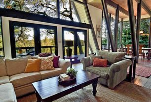 Traditional Living Room with Exposed beam, Hardwood floors, Columns, French doors, High ceiling, picture window