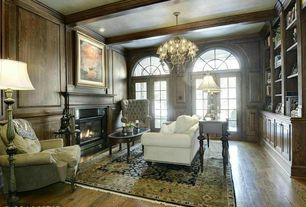 Contemporary Home Office with Standard height, Fireplace, Transom window, Chandelier, Hardwood floors, can lights