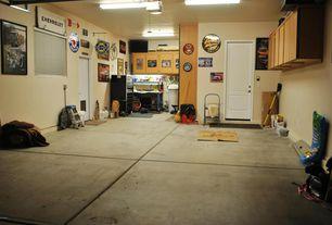 Traditional Garage with specialty door, Concrete tile , Built-in bookshelf, flush light