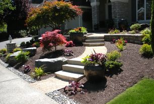 Traditional Landscape/Yard with Exterior light fixture with fence post cap base, Pea gravel, exterior tile floors, Casement