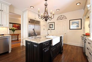 Traditional Kitchen with Framed Partial Panel, Kitchen island, Hardwood floors, Standard height, Complex granite counters