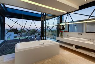 Contemporary Master Bathroom with Master bathroom, Skylight, Double sink, Corian counters, Exposed beam, Vessel sink