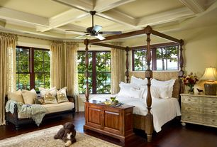 Traditional Master Bedroom with Exposed beam, Hardwood floors, Window seat, Ceiling fan, Built-in bookshelf