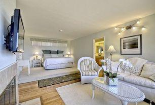 Cottage Guest Bedroom with Carpet, bedroom reading light, Paint 1, Standard height, Hardwood floors