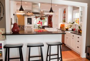 Traditional Kitchen with Flat panel cabinets, Quartz counters, Wood counters, Crown molding, Kitchen island, Glass panel