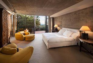 Modern Master Bedroom with Built-in bookshelf, Catie Headboard, flush light, Carpet, Knoll (R) Cini Boeri Lounge Chair