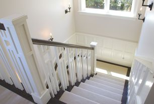Craftsman Staircase with Chair rail, Cathedral ceiling, Carpet, Wall sconce, Wainscotting