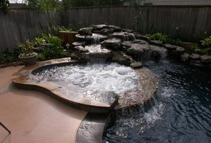 Rustic Hot Tub with exterior stone floors, Fountain, Fence, Pool with hot tub