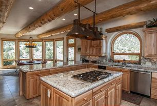 Rustic Kitchen with electric cooktop, Multiple Sinks, Complex granite counters, Chandelier, limestone tile floors, Casement