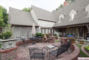 Cottage Patio with Casement, outdoor pizza oven, exterior brick floors, French doors