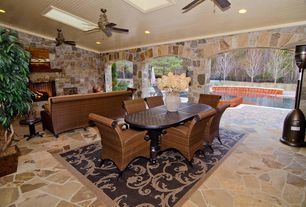 Tropical Patio with stone fireplace, Interior flagstone flooring, Pool with hot tub, Stone archway, can lights, Ceiling fan