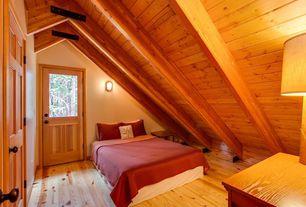 Rustic Guest Bedroom with Glass panel door, Hardwood floors, Exposed beam