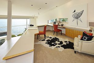 Modern Home Office with Columns, Oly Studio Benjamin Chair, Standard height, Back & White Cowhide Rug, can lights, Carpet