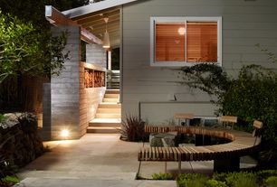 Contemporary Patio with Raised beds, exterior tile floors