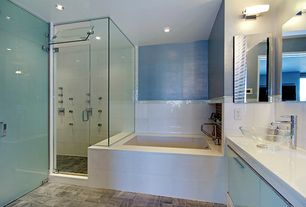 Contemporary Master Bathroom with Large Ceramic Tile, Corian counters, Master bathroom, Vessel sink, Flush, European Cabinets