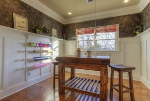 Cottage Home Office with Crown molding, Wainscotting, Hardwood floors, interior wallpaper, Pendant light