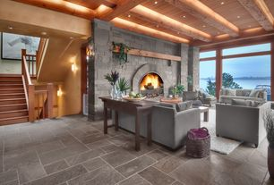 Traditional Great Room with Porcelain bullnose floor tile, stone fireplace