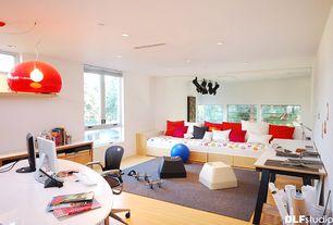 Modern Home Office with Hardwood floors, Pendant light, Window seat