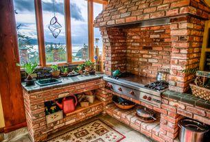 Rustic Kitchen with High ceiling, Brick veneer, Concrete floors, Built-in bookshelf, interior brick, Pendant light