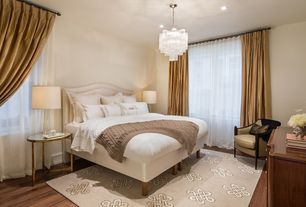 Contemporary Master Bedroom with Beran accent table, Queen notched upholstered headboard, Area rug, Chandelier