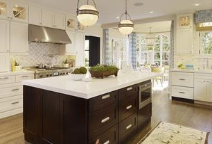 Traditional Kitchen with French doors, Breakfast bar, Flush, Caesarstone 2141 Blizzard, Corian counters, Flat panel cabinets