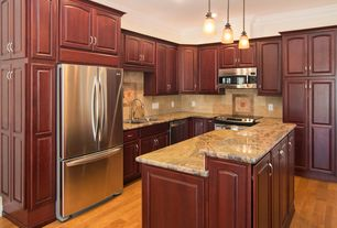Traditional Kitchen with Stone Tile, Crown molding, Raised panel, Limestone Tile, Pendant light, Kitchen island, L-shaped