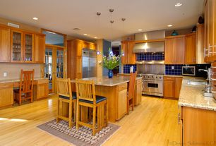 Craftsman Kitchen with double oven range, Simple granite counters, Daltile PERIWINKLE  Field Tile, full backsplash, Wall Hood