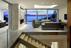 Contemporary Living Room with can lights, stone tile floors, sandstone tile floors, picture window, Standard height