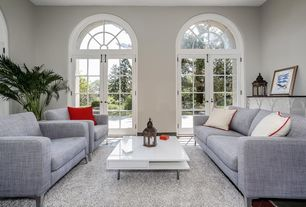 Contemporary Living Room with Transom window, French doors, Built-in bookshelf, Elle Modern Coffee Table, Arched window