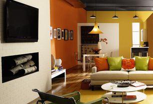 Modern Living Room with Window seat, specialty window, Laminate floors, Standard height, Pendant light