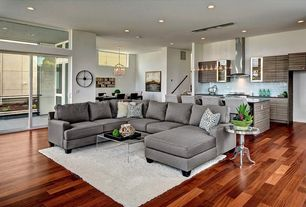 Contemporary Living Room with Hardwood floors, can lights, sliding glass door, picture window, Standard height