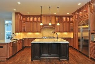 Craftsman Kitchen with Pendant light, two dishwashers, Stone Tile, Glass panel, Undermount sink, Raised panel, U-shaped