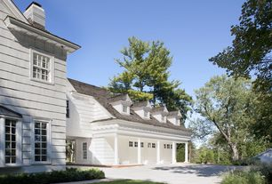 Traditional Garage with Barn door, Columns, Carriage house garage doors, Concrete floors, Clapboard siding