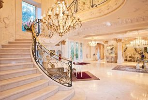 Traditional Entryway with Columns, curved staircase, stone tile floors, Stained glass window, Chateau d'or, Gold capitals