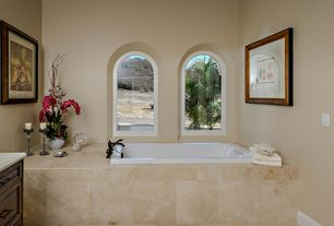 Traditional Master Bathroom with Wall Tiles, Arched window, stone tile floors, Bathtub, Limestone counters, High ceiling